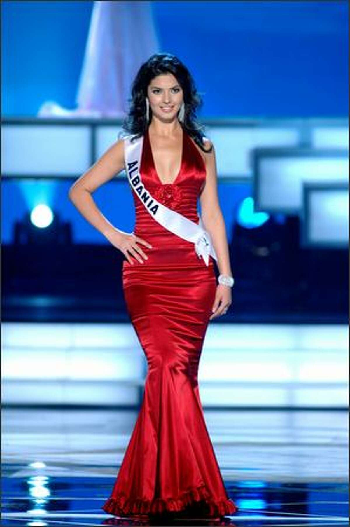 Agnesë Vuthaj, Miss Albania, competes in an evening gown of her choice during the 2005 Miss Universe Presentation Show at Impact Arena, Exhibition and Convention Center in Bangkok, Thailand on May 26. During the presentation show, each contestant was judged by a preliminary panel of six judges in swimsuit and evening gown categories, after two days of one-on-one interviews. The scores will be tallied and the top 15 contestants will be announced during Monday's telecast (NBC, tape-delayed to 9 p.m. PDT), at the conclusion of which a winner will be crowned.