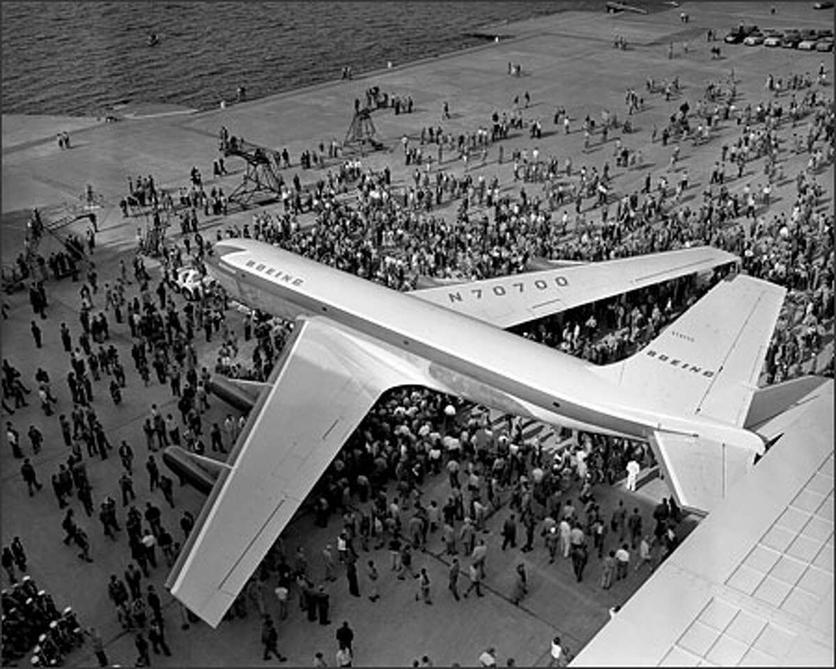 On May 14, 1954, Boeing rolled out the Dash 80, the prototype for the famous 707 jet transport. Thousands gathered at the Renton plant and watched Bertha Boeing, wife of the company's founder, christen the plane with champagne. Boeing gambled that airlines would want to switch to jet planes from the slower propeller-driven aircraft in use at the time. The 707 would prove to be the first of the company's successful line of commercial jets.