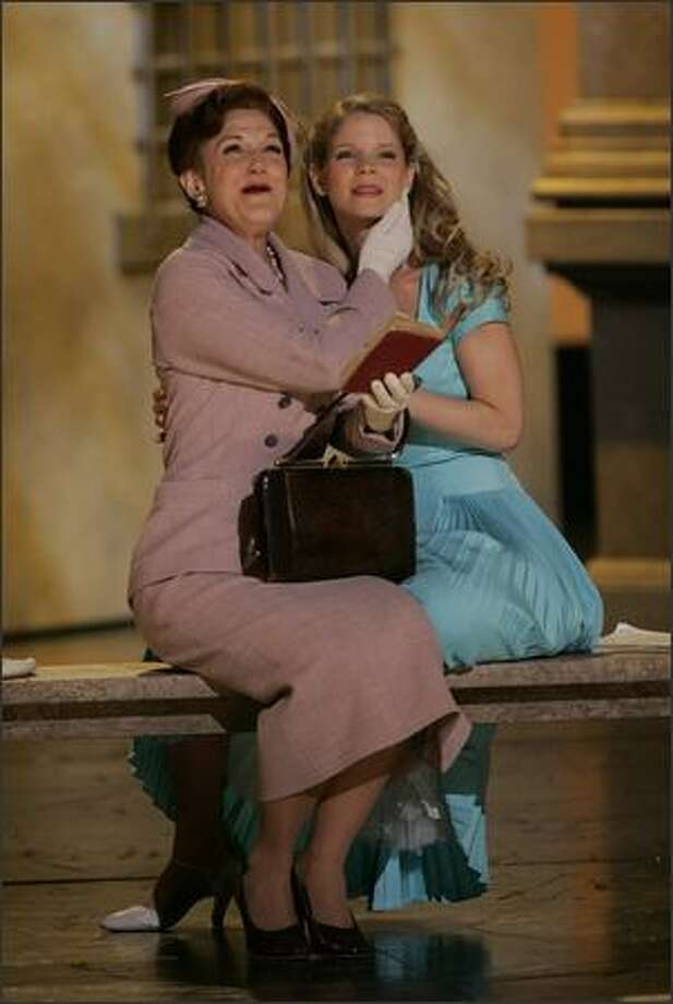 "Victoria Clark, left, and Kelli O'Hara perform a number from the Broadway musical ""The Light in the Piazza"" at the 2005 Tony Awards. ""Piazza,"" developed at Seattle's Intiman Theatre, won six Tonys, including best performance by a leading actress for Clark. (AP Photo/Kathy Willens) Photo: Associated Press"