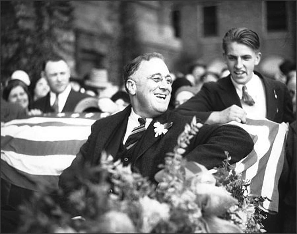 Just before his election as President of the United States, New York governor Franklin Delano Roosevelt visited Seattle in 1932. He flashed his famous smile from an open touring car, surrounded by an admiring crowd. The governor, born in 1882, stricken with polio in 1921, would be elected to a record four terms as president, serving until his death in 1945.