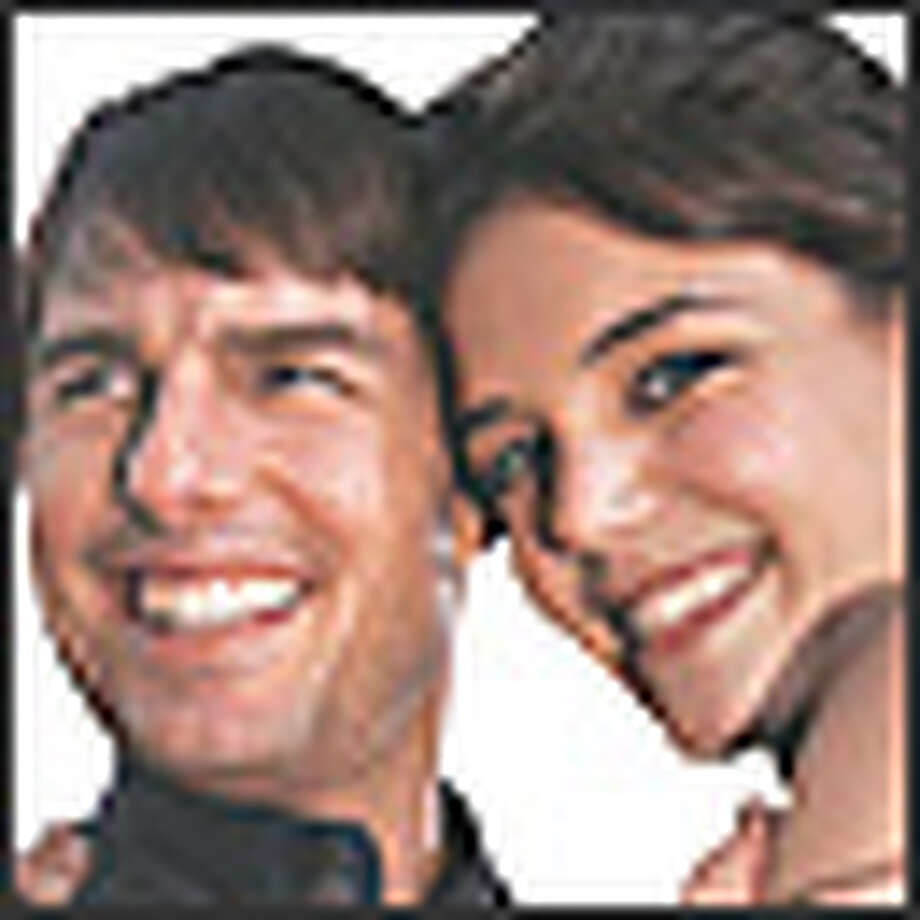 Tom Cruise and Katie Holmes: too much teeth and posing for the real thing.