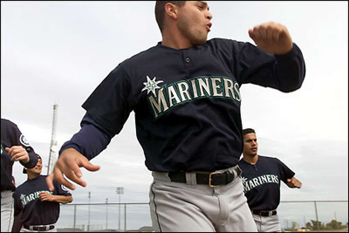 Pitcher Joel Pineiro works on a conditioning drill for pitchers at Mariners spring training camp in Peoria, Ariz.