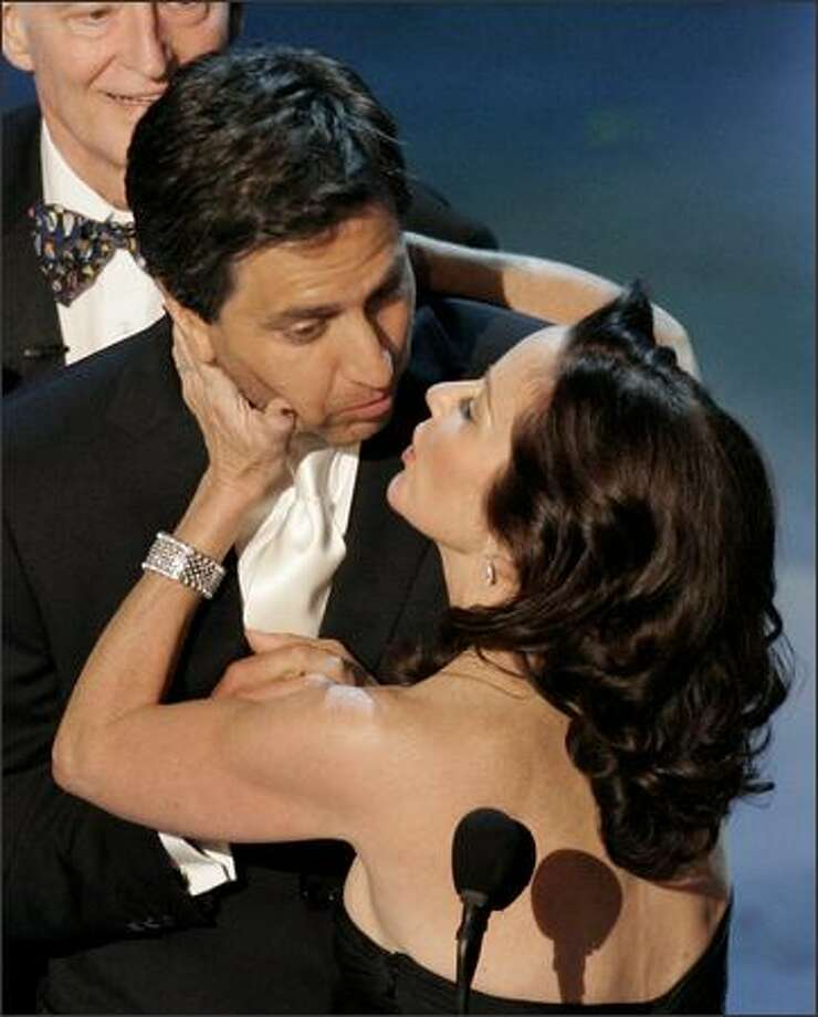 "Ray Romano, star of the comedy series ""Everybody Loves Raymond,"" is kissed by co-star Patricia Heaton as the cast came on stage to make an award presentation during the 57th Annual Primetime Emmys. (AP Photo/Mark J. Terrill) Photo: Associated Press"