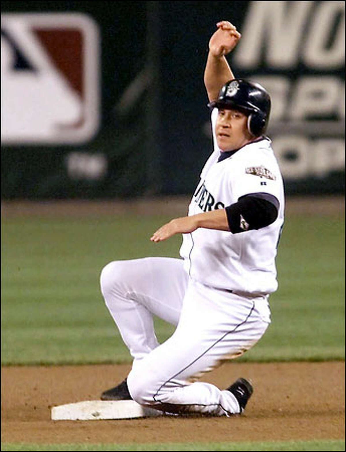 Bret Boone, running on a 3-2 pitch to Mike Cameron in the fourth inning, looks to see that ball four was called. Boone was in the lineup as the DH.