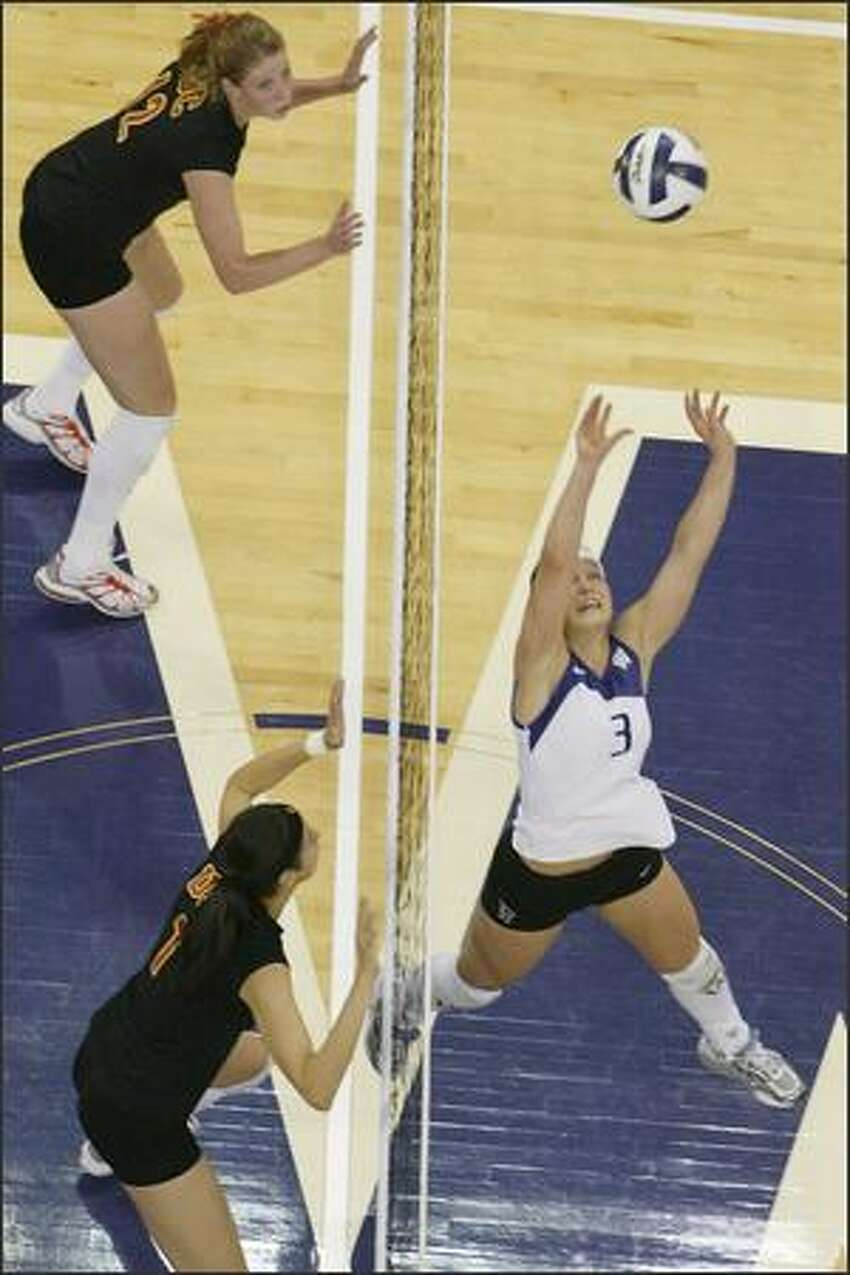Courtney Thompson sets the ball for a kill during UW's win against USC in Seattle. Thompson earned first-team All-American honors last year after ranking third nationally with 14.67 assists per game.
