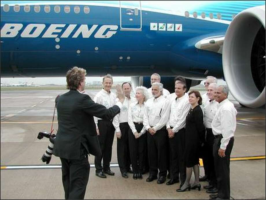 The Worldliner's flight crew poses for a group photo after landing at London's Heathrow Airport following a record-making, 22-hour-and-42-minute, nonstop flight from Hong Kong. Photo: James Wallace, Seattle Post-Intelligencer