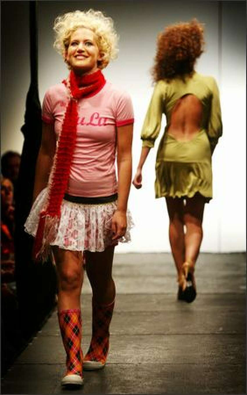 Elle wears a Do You Lulu Tee and a Rebe lace skirt during a fashion show featuring botiques in the Belltown area.