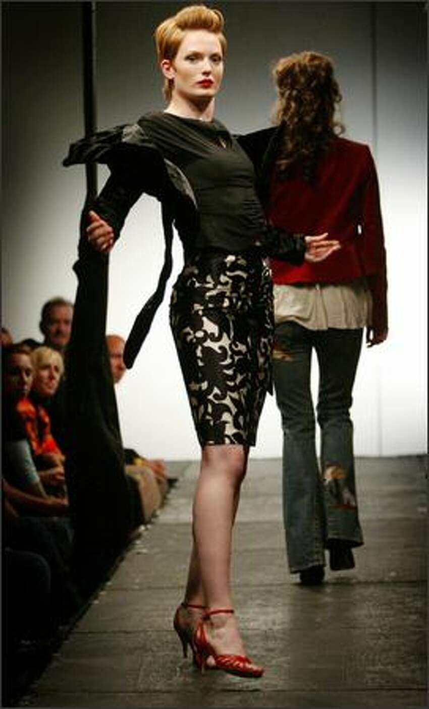 Sam wears a Milly outfit from Sway and Cake during a fashion show featuring botiques in the Belltown area.