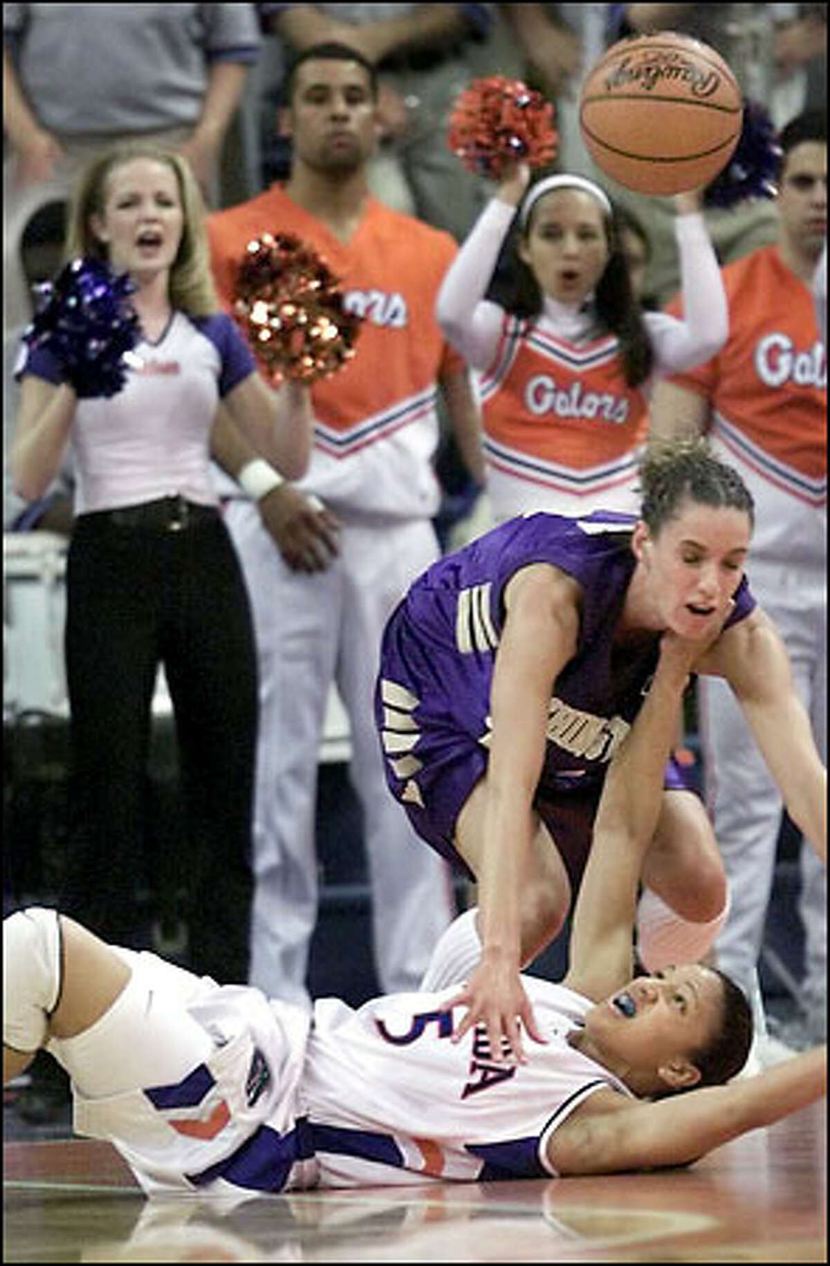 Megan Franza battles with Tombi Bell in the 2nd half for rebound against Florida.