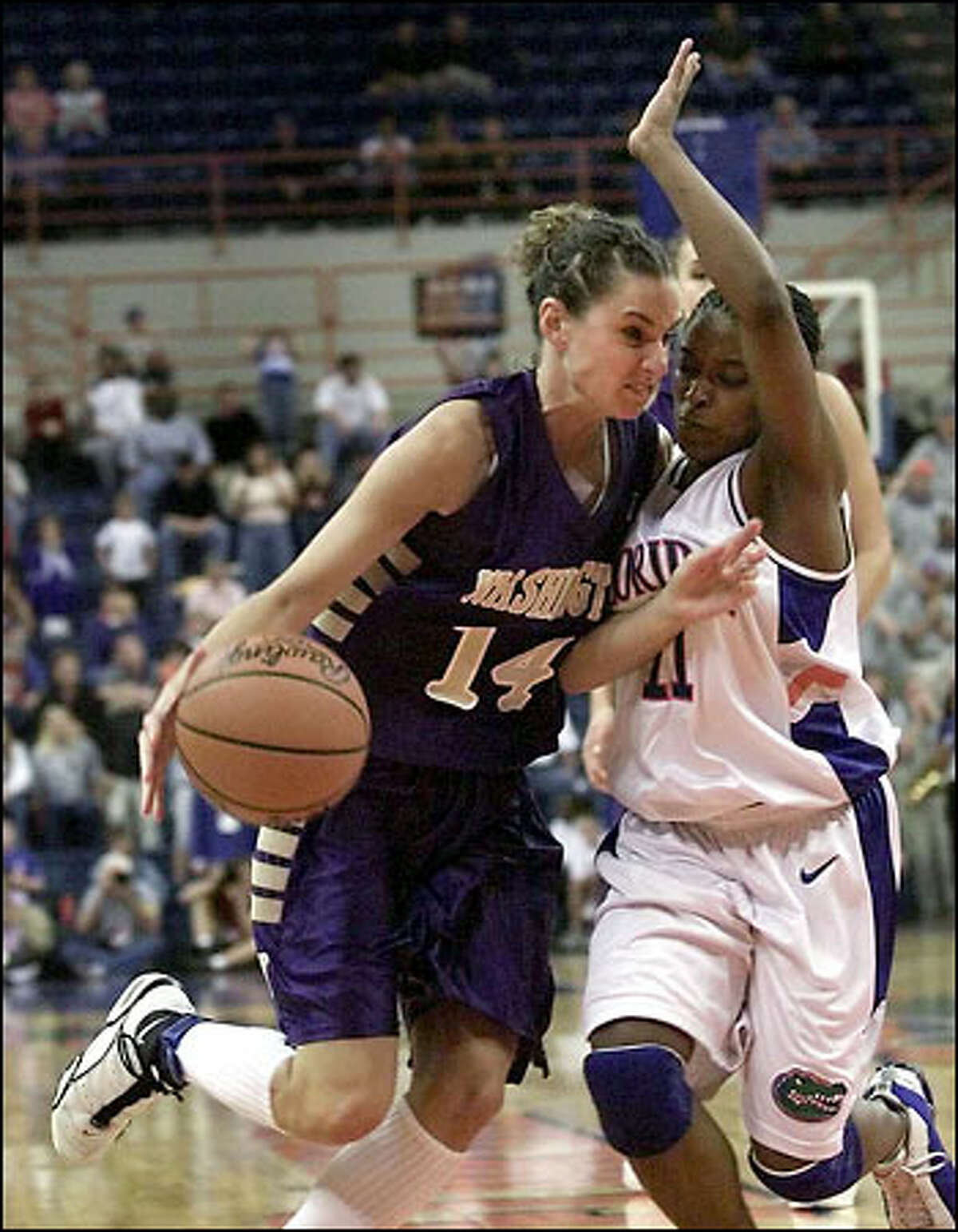 Megan Franza drives against Brandi McCain to the basket in UW's win over the University of Florida and a trip to the sweet 16.