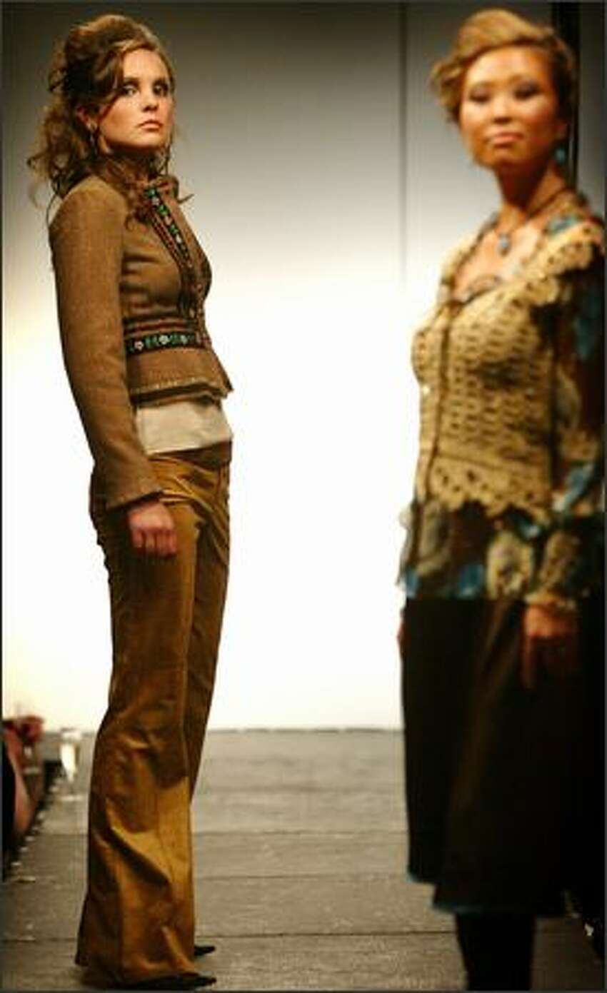 Kelland, left, wears a Nanette cropped jacket and gold pants from Alhambra during a fashion show featuring botiques in the Belltown area.