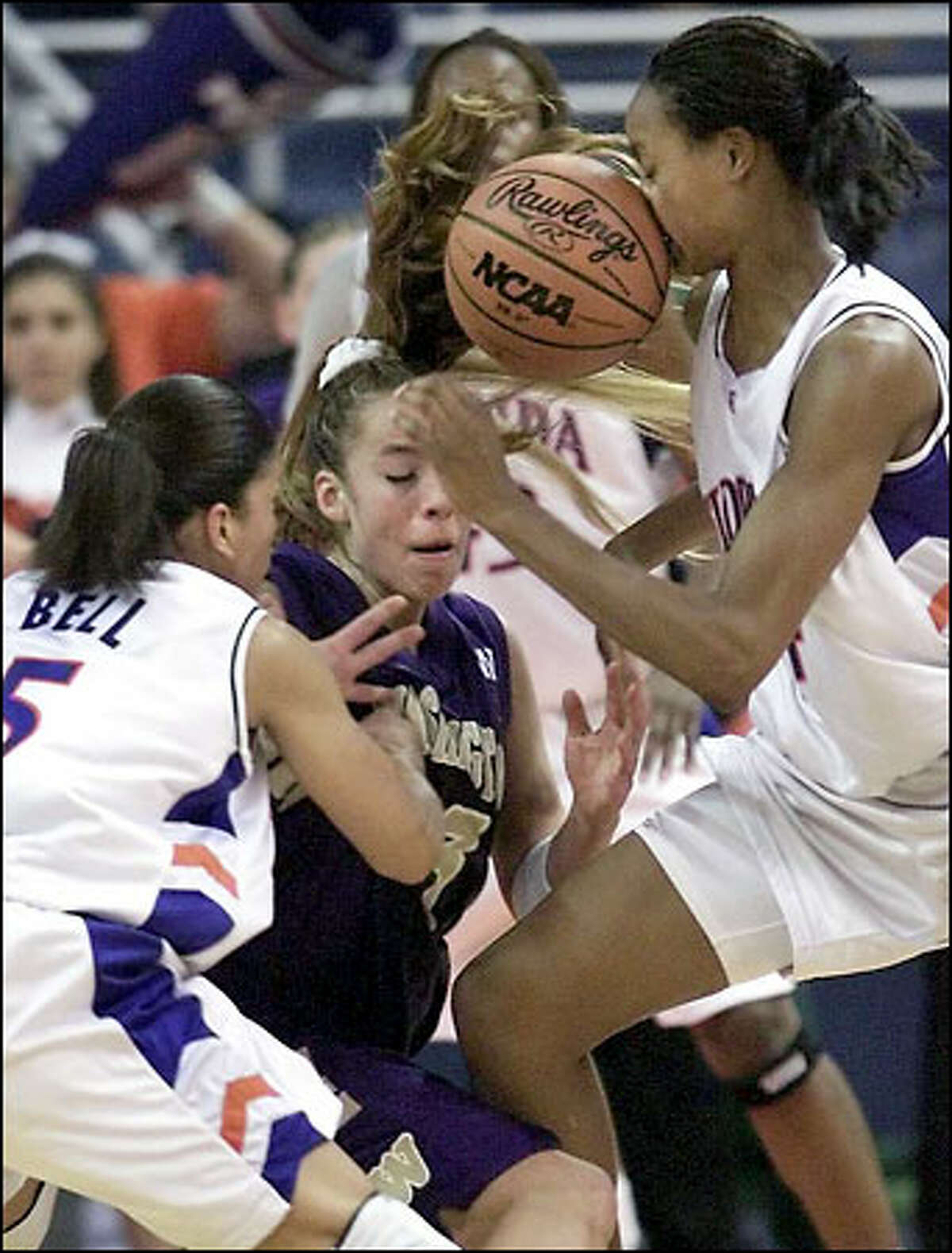 Tombi Bell and Tamara Stocks battle Guiliana Mendiola for the ball in the second half.