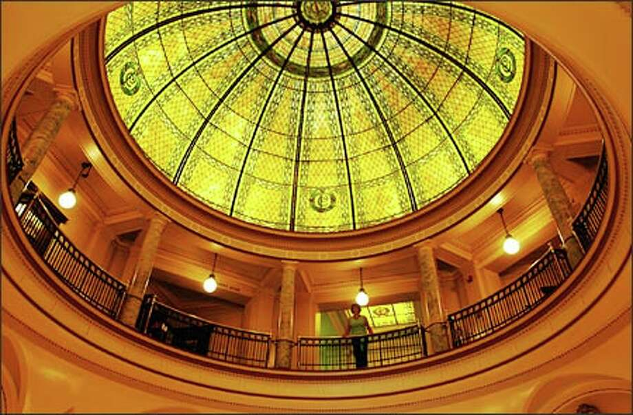 The spacious Pacific County Courthouse in South Bend, Wash., feels as if it should be in Washington, D.C. Shown is its art glass dome. Photo: Jeff Larsen, Seattle Post-Intelligencer