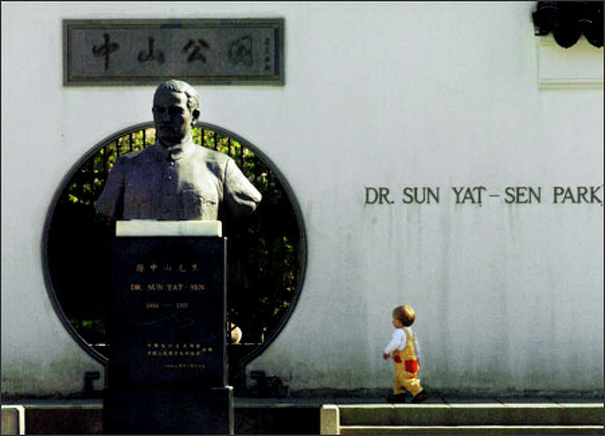 The bust of Dr. Sun Yat-Sen dominates the park adjacent to the Chinese Cultural Centre and Dr. Sun Yat-Sen garden in Vancouver, B.C.'s Chinatown.Larsen: Vancouver B.C.'s Chinatown is full of visual surprises. The small Asian child was a nice contrast to the bust on display.