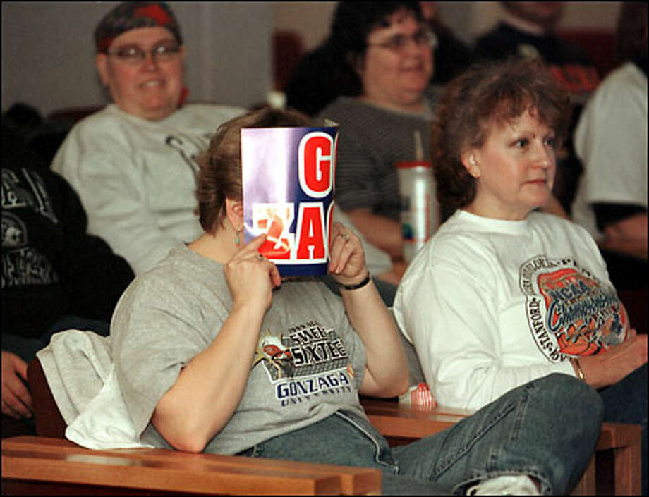 Gonzaga faculty member Stephanie Plowmay couldn't bear to watch some of the action in the game against Virginia -- but the Zags ended up winning by a razor-thin 86-85 score. Photo: Jeff T. Green, For The Seattle Post-Intelligencer