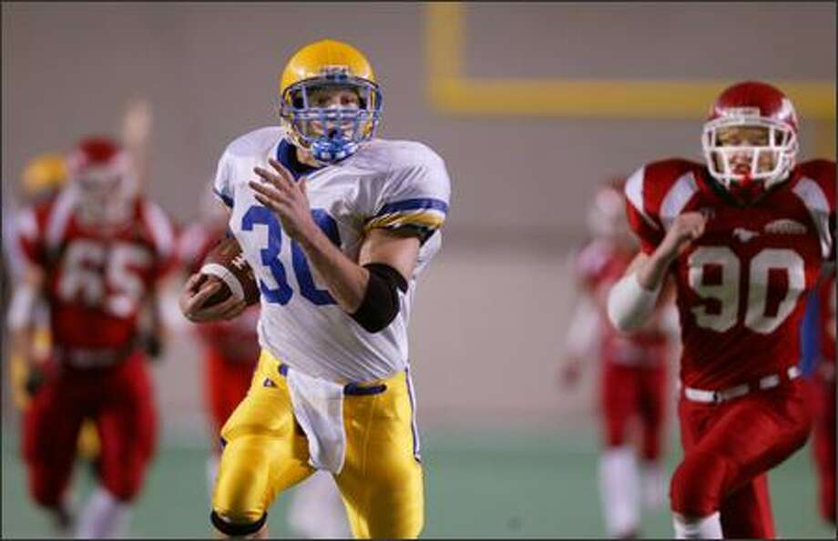 Ferndale running back Adam Wilgus scores a touchdown on the first play from scrimmage, rambling 67 yards past Prosser defenders, including Josh Beck. Photo: Scott Eklund, Seattle Post-Intelligencer