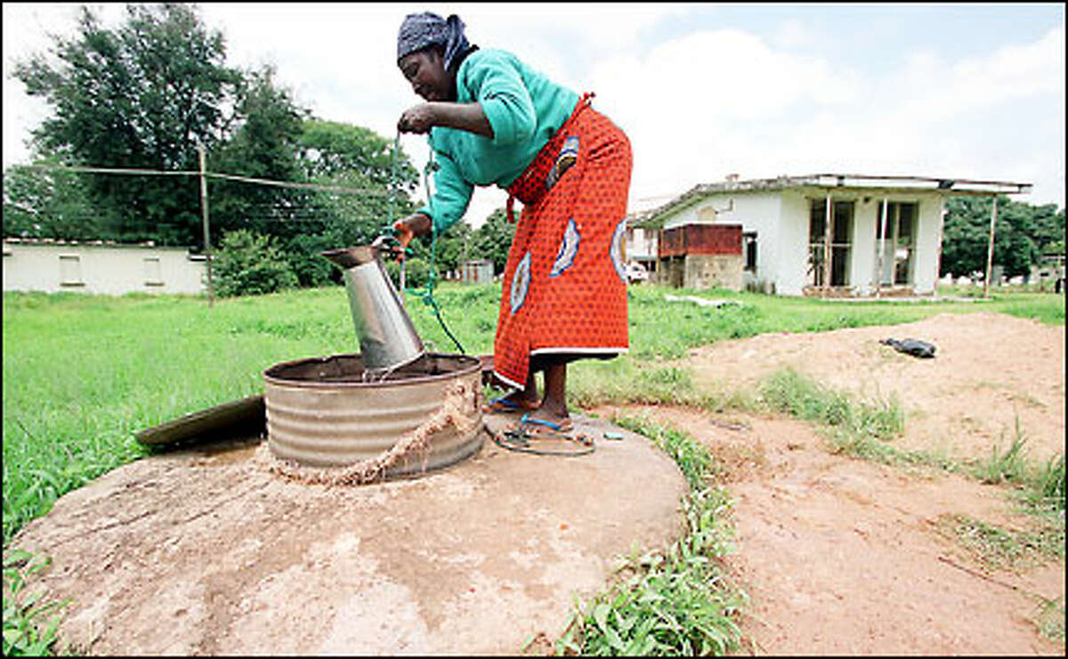 At Plateau State Hospital in Jos, water is drawn from a well for patient needs, from drinking and washing to minor surgery.