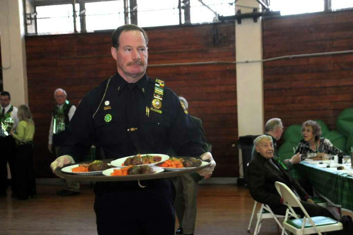 Greenwich Police Lt. Richard Cochran serves lunch at Greenwich Senior Center's St. Patrick's Party at the Eastern Greenwich Civic Center, on Thursday, March 17, 2011.
