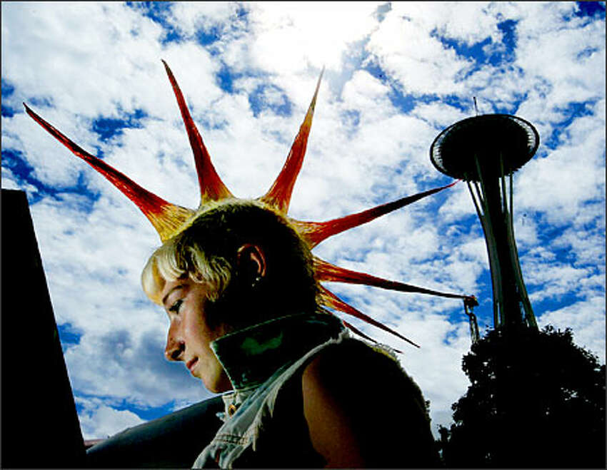 Comice Johnson, 17, came from Eugene, Ore., to listen to the many bands performing at the Bumbershoot arts festival at the Seattle Center.Eklund: Bumbershoot is one of the best festivals in Seattle. You get a great mix of characters. I had a strobe on a cord and I had one of her friends hold my light, while I took a few shots of her after a concert.