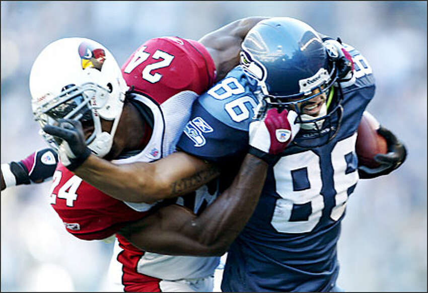 Seahawks tight end Jerramy Stevens tries to fight off Arizona safety Adrian Wilson as he get knocked out of bounds at the 2-yard line.Eklund: At the time I thought it was funny, because Stevens had hold of Wilson's facemask first. Wilson got mad, so he grabbed Stevens' mask. The official called the penalty on Wilson. I can't think of many times I have seen the officials call facemasking on the offense on a play like this, but it happens quite a bit.