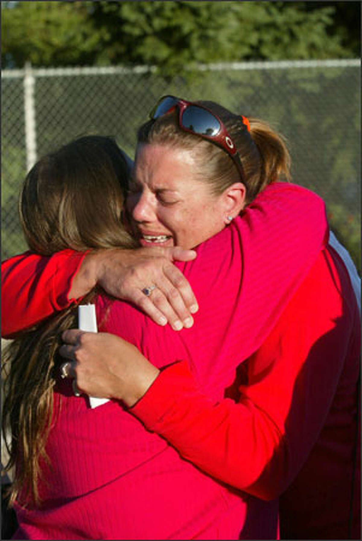 Jane Jesse Smith, right, hugs childhood friend Heidi Ackerman as they reunite for the first time in 23 years Tuesday in Seattle. Smith and her 10-year-old daughter, Randi, fled Bay St. Louis, Miss.