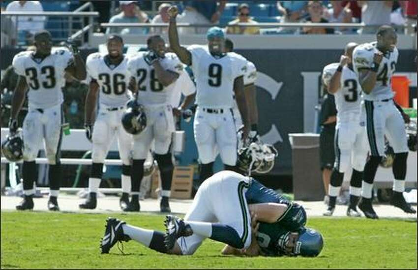 Jacksonville players celebrate after watching Seahawks quarterback Matt Hasselbeck go down hard and fumble late in the final seconds of the game.