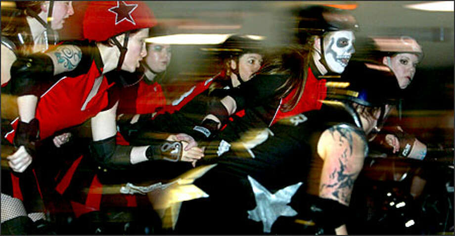 The Rat City Rollergirls opened their 2005 season at Southgate Roller Rink in White Center working the jam and trying to knock each other down.Ducey:This was my first multimedia project. These girls were wild and the story lent itself well to the sound and motion video can capture. Photo: Karen Ducey, Seattle Post-Intelligencer