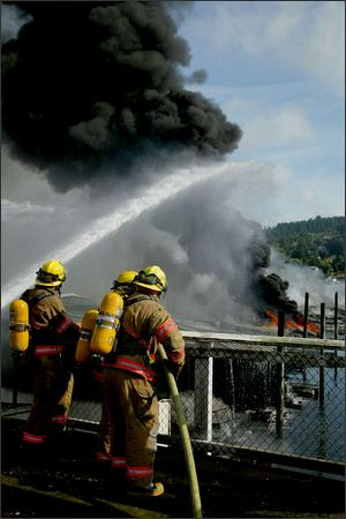 Firefighters fight a fast-moving fire at the Harborview Marina in downtown Gig Harbor.