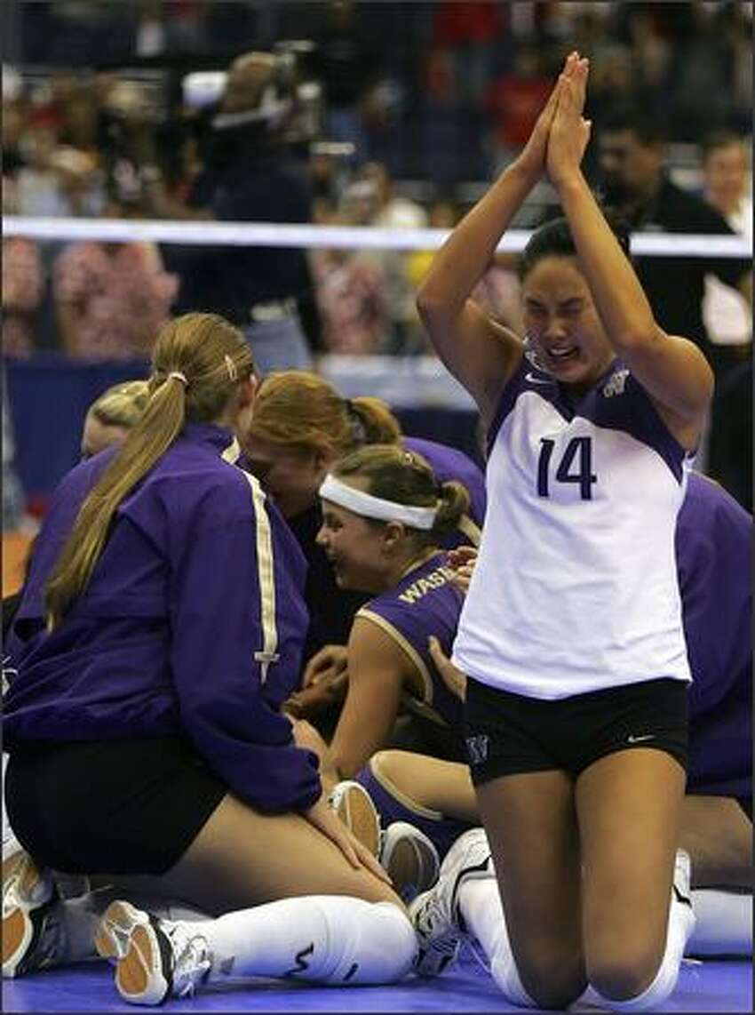 Candace Lee celebrates with teammates after winning the national volleyball title.