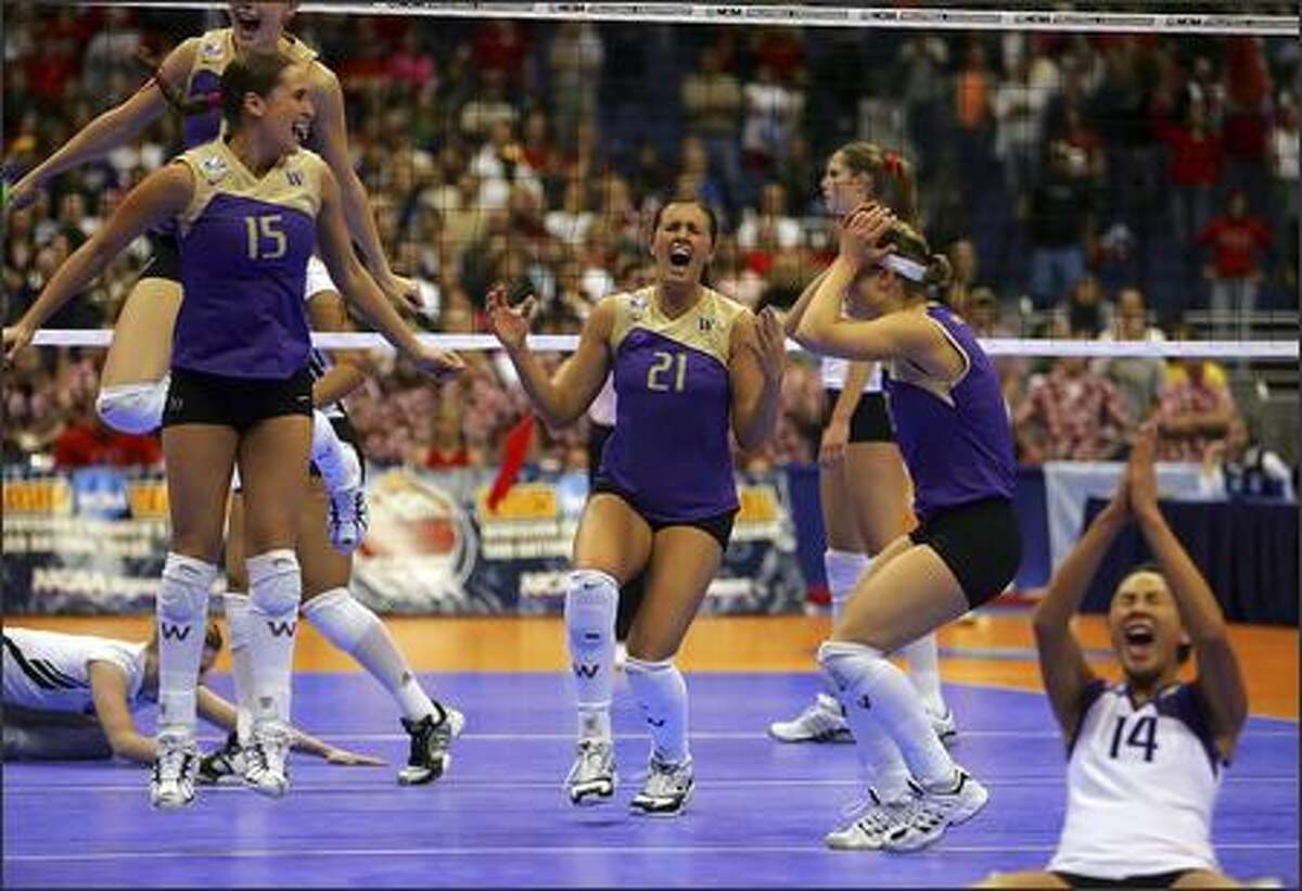 Washington Huskies players celebrate the final point in their match against Nebraska at the Alamodome. The Huskies won the championship in three straight sets.
