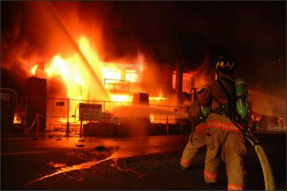 An early morning fire destroyed a nearly completed condominium/retail   development in downtown Edmonds on Saturday. The building, which was   to be named The Gregory, caused controversy in Edmonds because of its   size. Firefighters were still hosing down hotspots at 3 p.m.   Saturday, 12 hours after the blaze was discovered. More than 90   percent of the planned 28 condominium units had been presold. Photo: Scott Stoddard, Seattle Post-Intelligencer