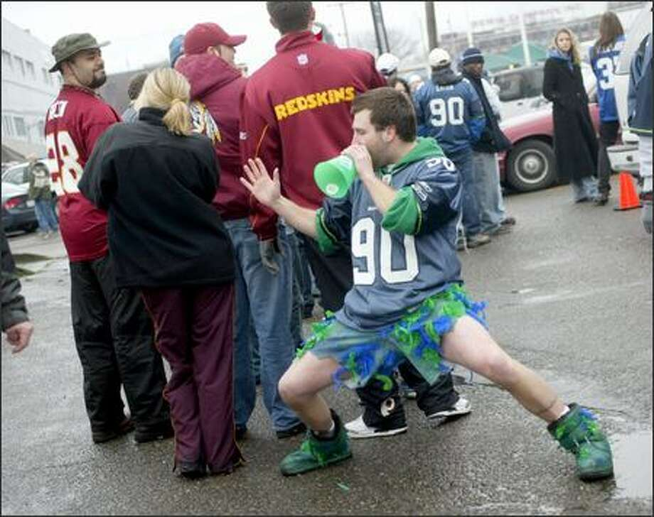 "Mark Hunsinger, who goes by the name ""Bird Man,"" heckles a group of Washington Redskins fans prior to the game outside of Qwest Field. Photo: Karen Ducey, Seattle Post-Intelligencer"