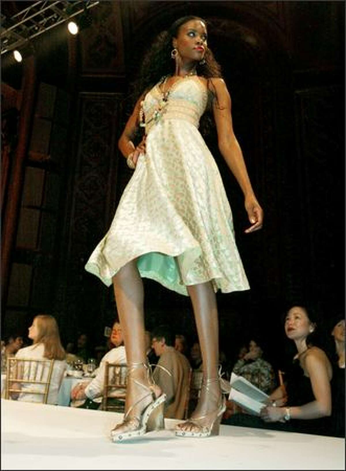 This Phoebe halter dress ($348) wowed the crowd at the Spring Preview fashion show. Studded platform shoes and oversize bags were prominent.