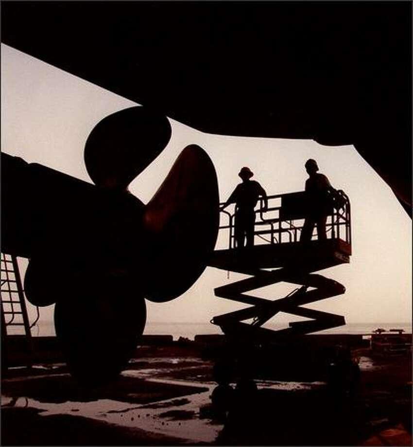 A mammoth propeller dwarfs workers at the Bellingham Bay Shipyard in Bellingham.