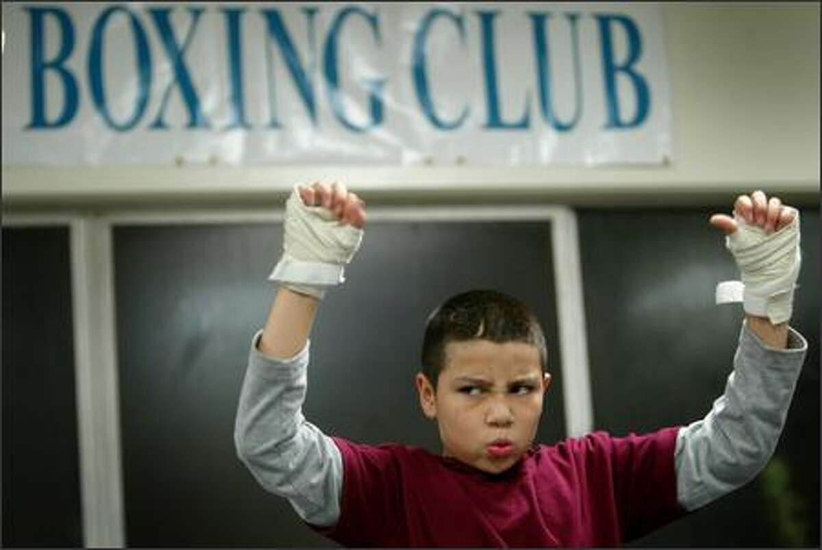 Rafael Garcia, 10, performs a hand exercise drill. He has been a boxer since he was 5.