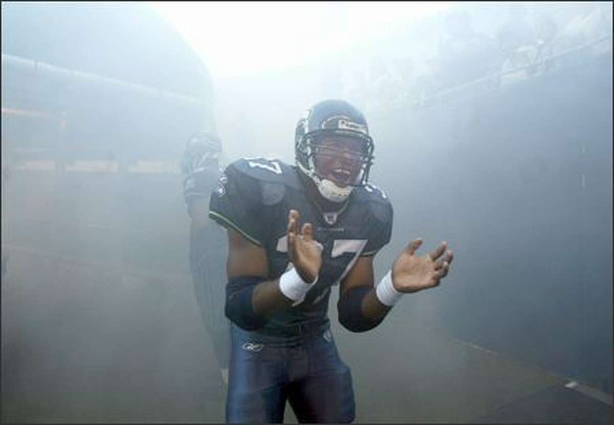 Shaun Alexander gets pumped up prior to running out onto the field through the tunnel and smoke before the start of a preseason game against the Minnesota Vikings on September 2, 2005.