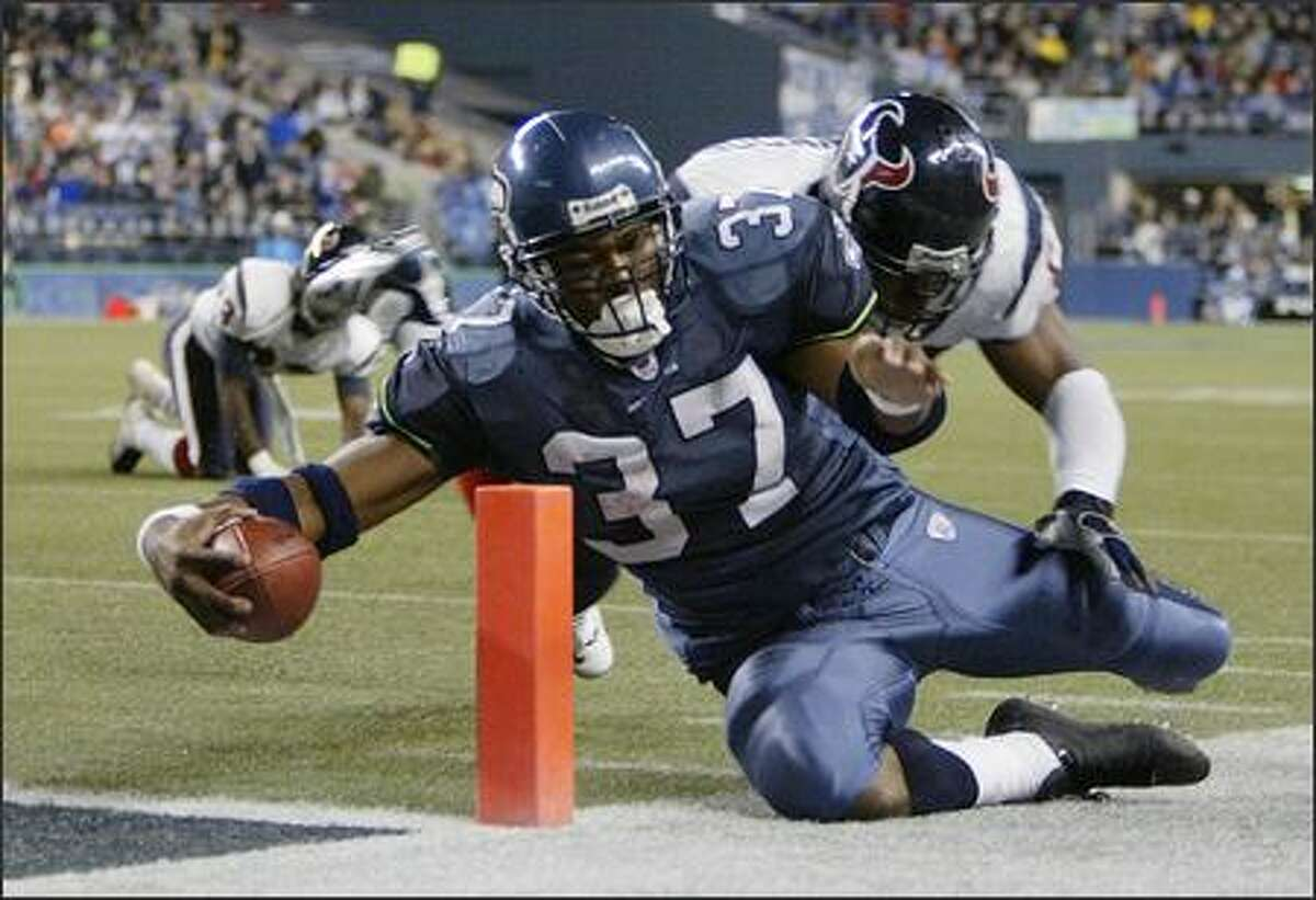 Shaun Alexander is driven out of bounds at the 2-yard line by Houston linebacker Marlon Greenwood during the third quarter on October 16, 2005.