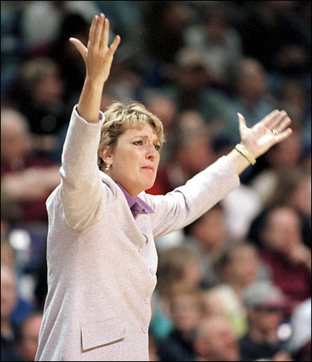 Washington head coach June Daugherty gestures during the last few minutes of the second half.