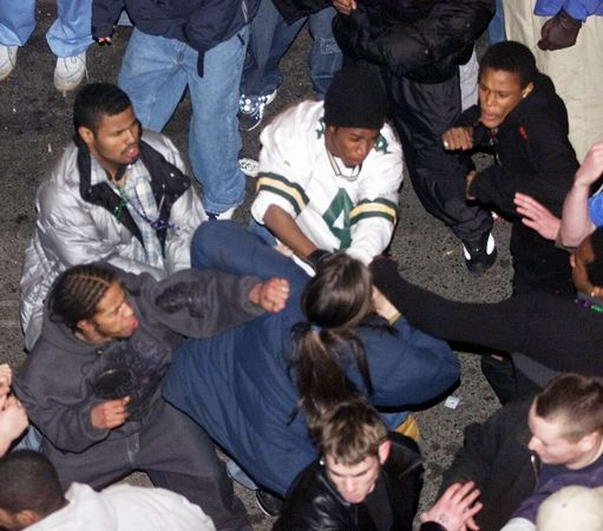 A group of young men beat another man in Pioneer Square as Fat Tuesday celebrations came to a close.