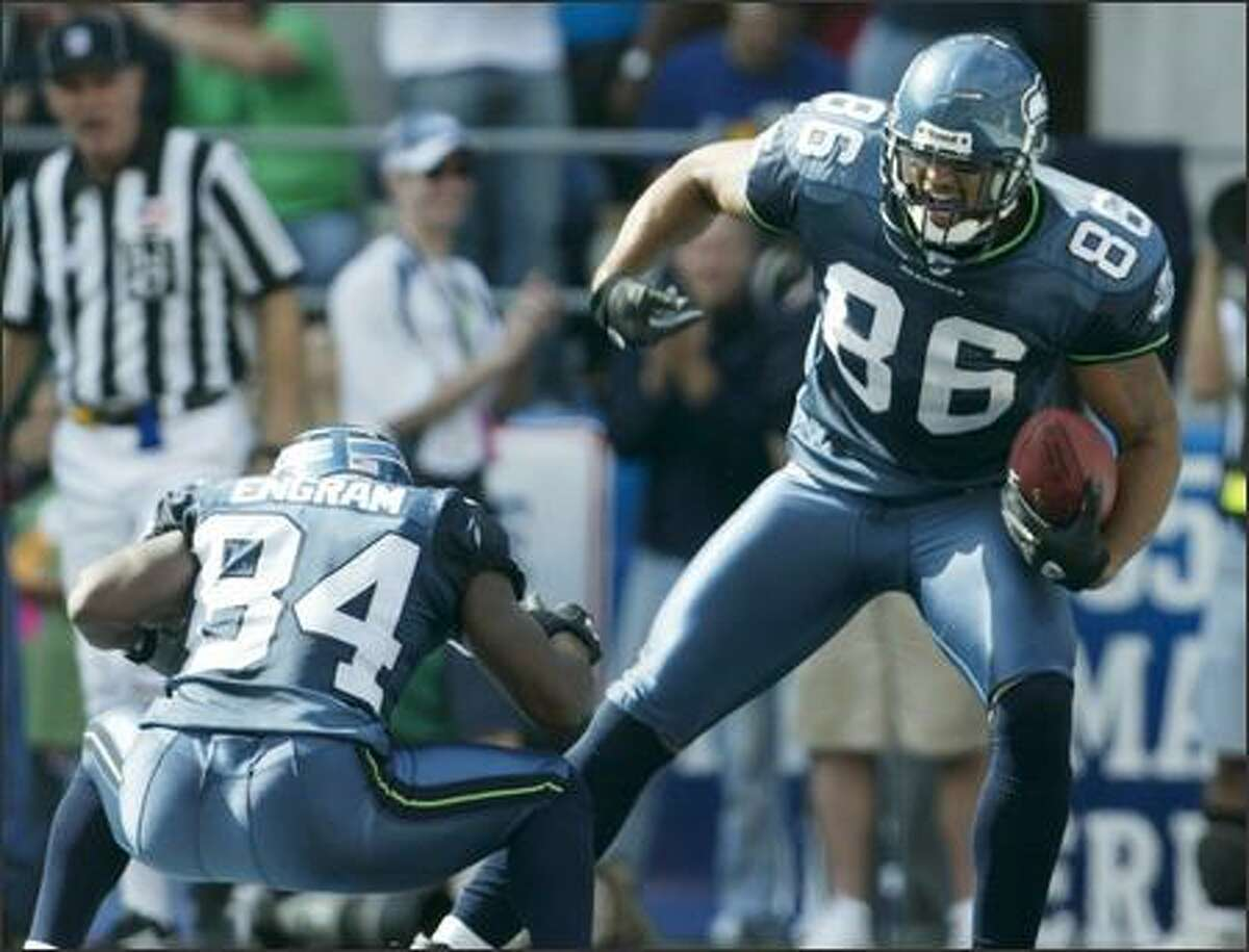 Seattle Seahawks' Jerramy Stevens celebrates his second quarter touchdown against the Atlanta Falcons with Bobby Engram on September 18, 2005.