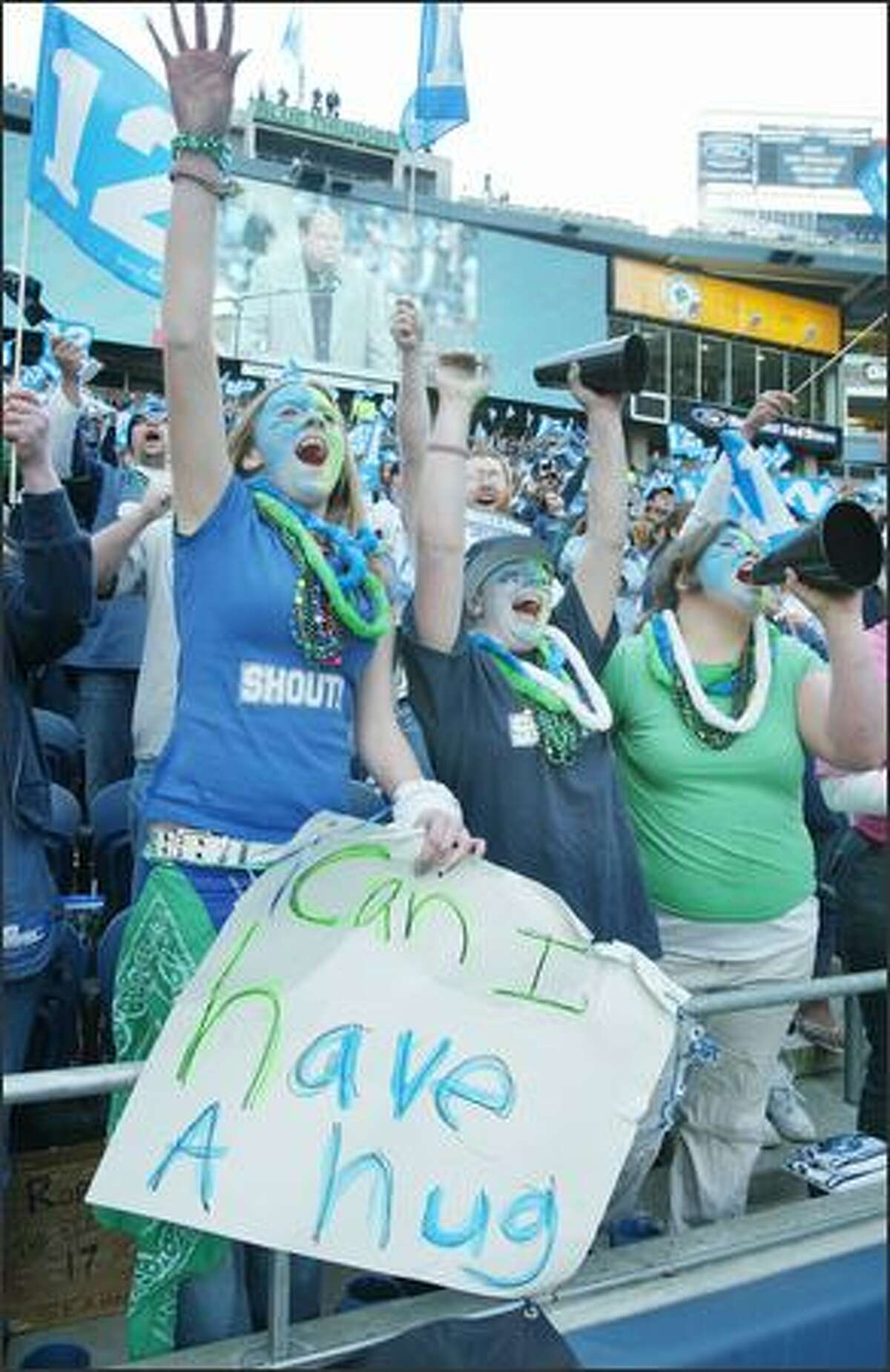 Left to right, Mickey Horgan, Malissa Dunn, and Gena Copley, all from Graham, Wash., attended the rally for the Seahawks return to Qwest Field.