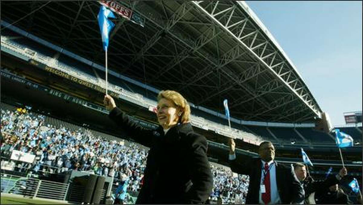 Governor Christine Gregoire leads King County executive Ron Sims and Mayor of Seattle Greg Nickels into Qwest Field for a rally celebrating the Seahawks.