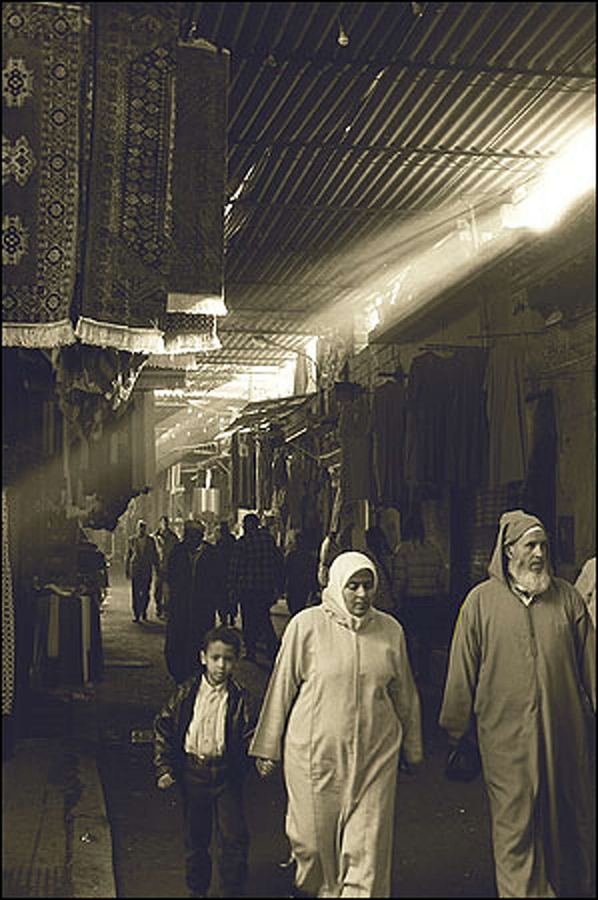 A covered souq in Marrakesh bustles from dawn til dusk. Photo by Laura Newlon.