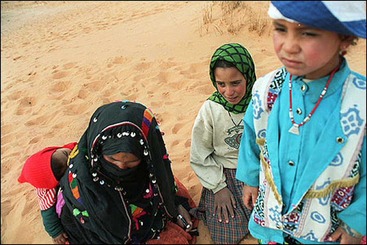 Nomadic Berber families, like this one, live in the dunes of the Sahara herding goats and camels. Berbers and their ancestors have long populated Morocco, and are fiercely independent people. Photo by Laura Newlon.
