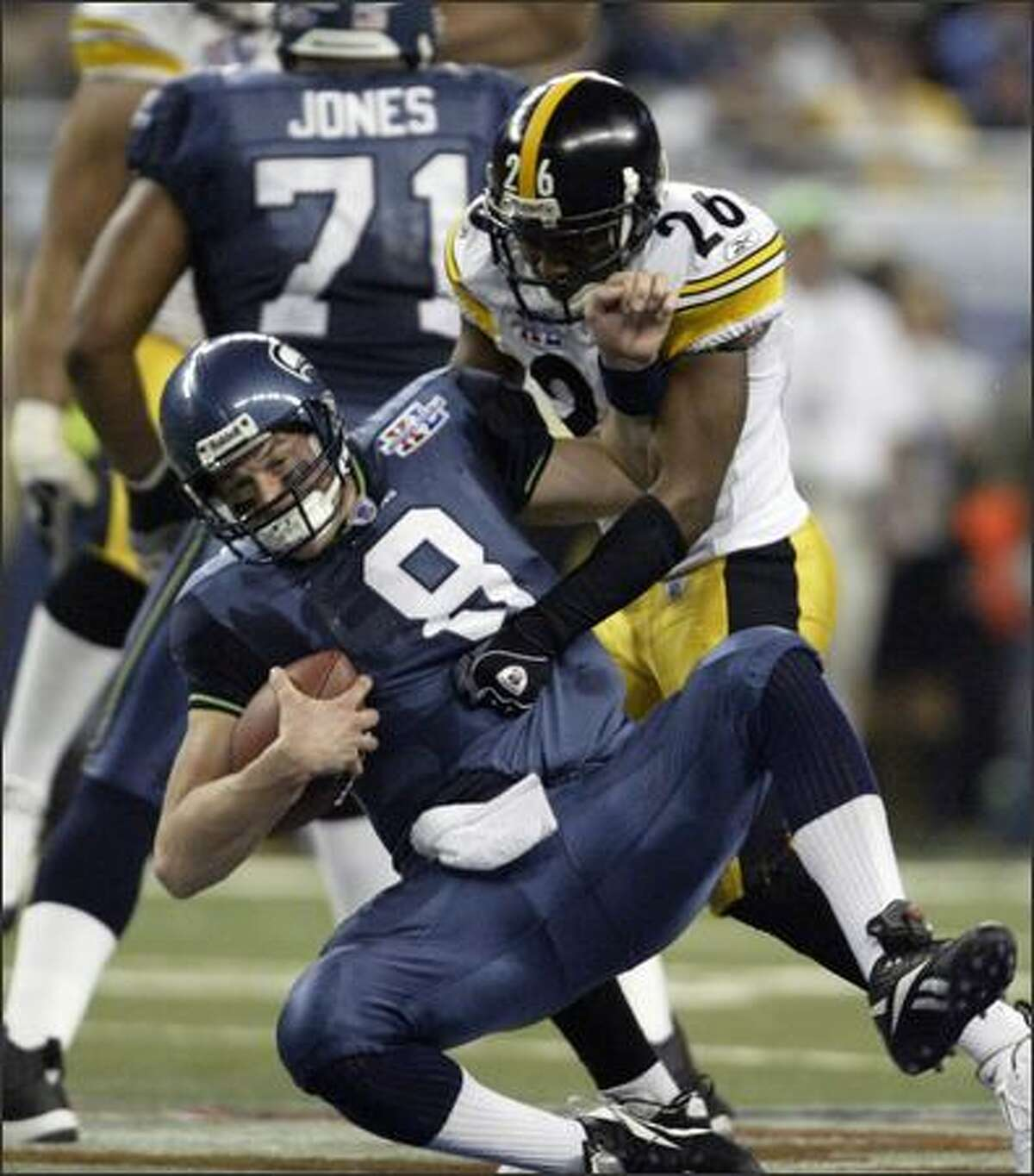 Matt Hasselbeck is taken down by Deshea Townsend in the fourth quarter.