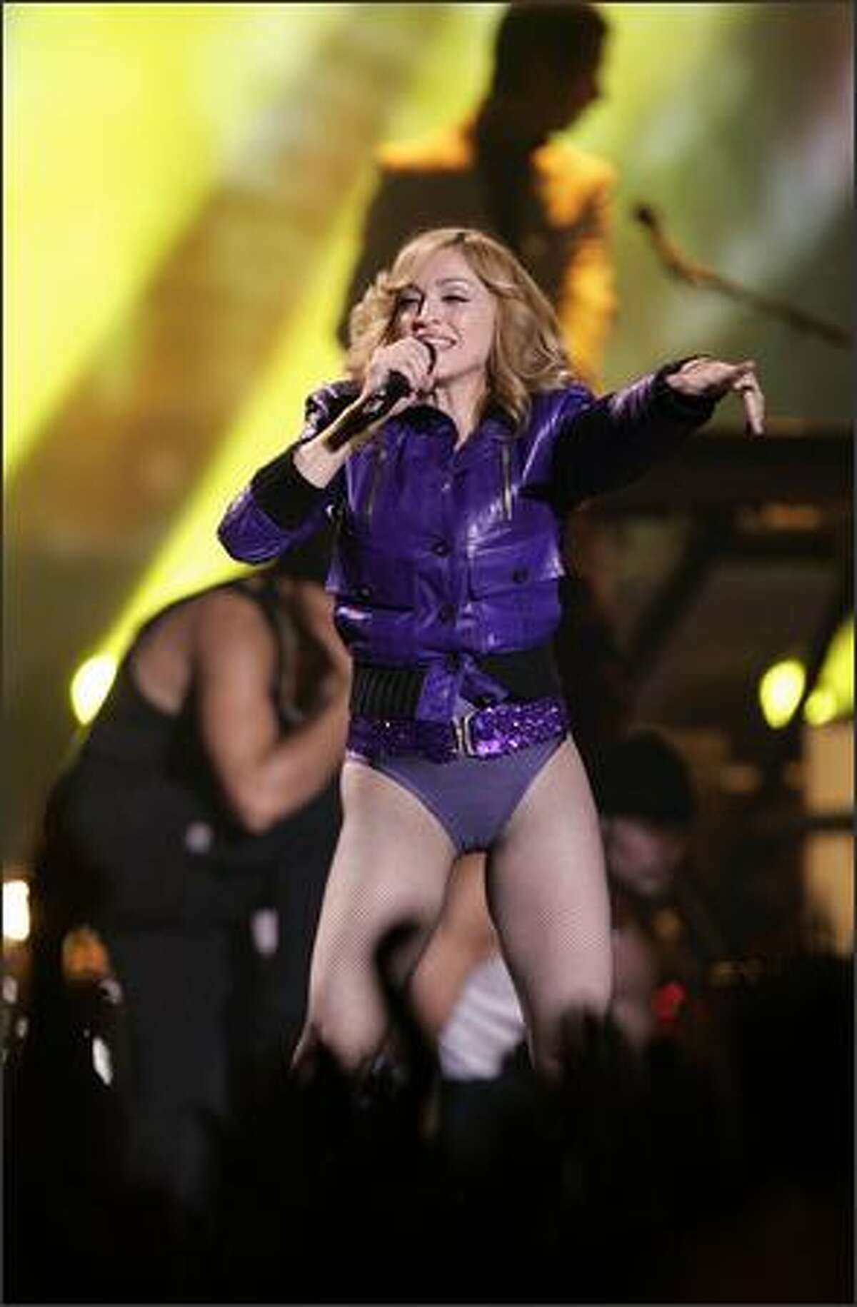 Madonna performs during the MTV Europe Music Awards ceremony at the Atlantic Pavillion in Lisbon, Portugal. (AP Photo/Armando Franca)