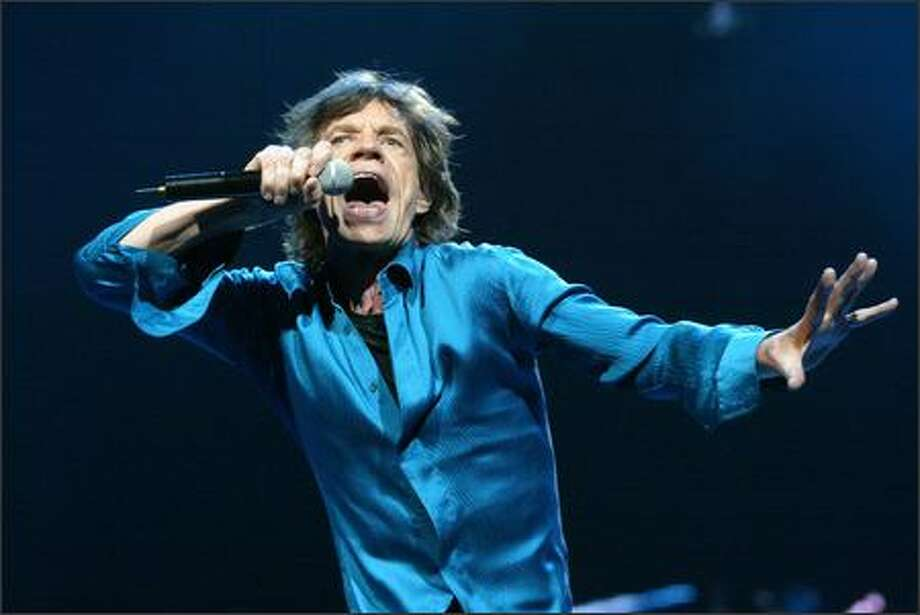 "Mick Jagger belts out ""Shattered"" as the Rolling Stones play KeyArena. Photo: Grant M. Haller, Seattle Post-Intelligencer"