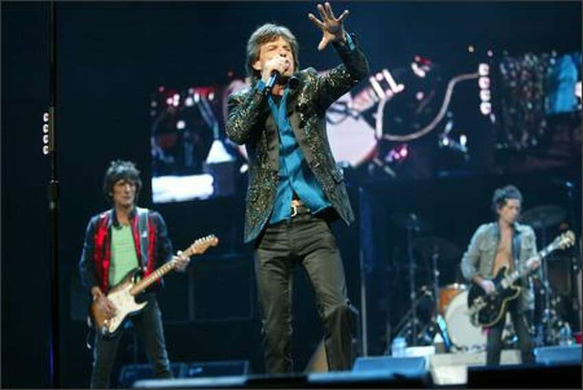 Mick Jagger, Ron Wood and Keith Richards lead off the show with