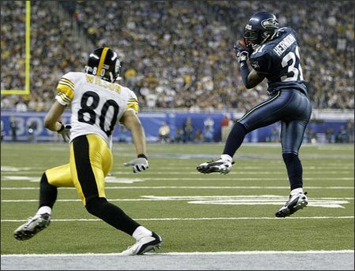 Seahawks defensive back Kelly Herndon pulls in an interception on a pass intended for Steelers receiver Cedrick Wilson in the third quarter. Herndon returned it 76 yards to set up Seattle's only touhdown.