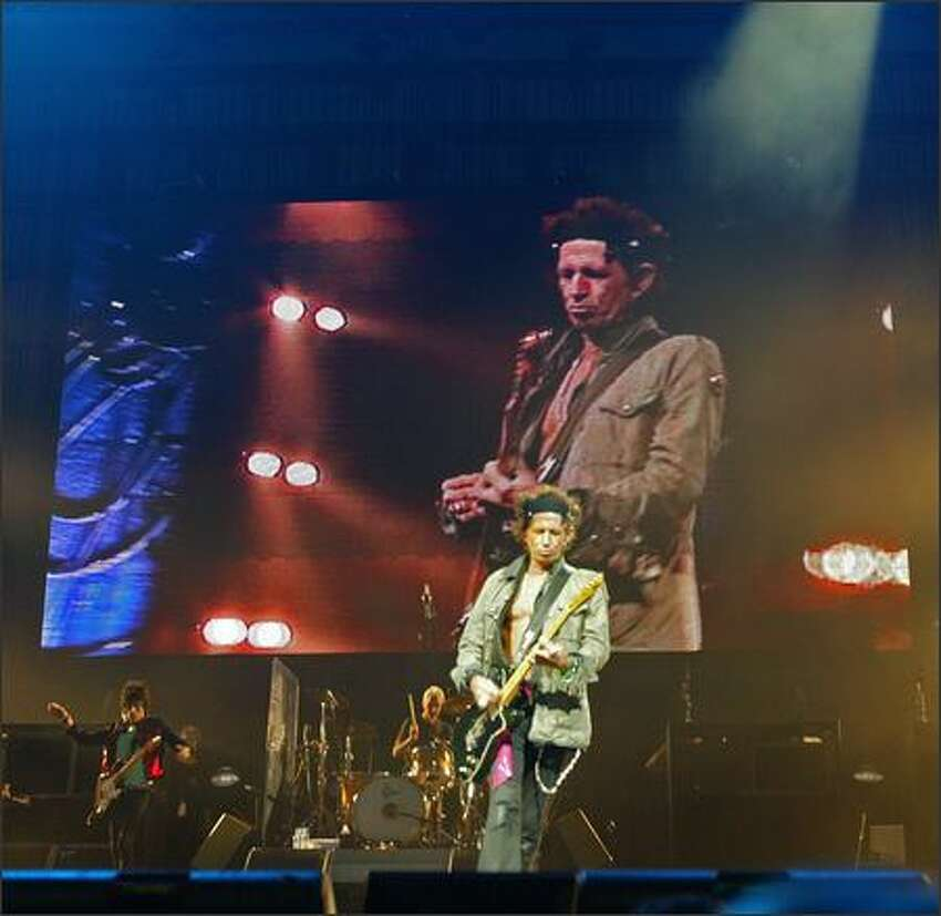 A giant video screen backs up Keith Richards as he performs